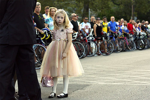 Seven-year-old Kylie Bruehler attends a memorial service for her parents.
